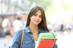 Relaxed student looking at camera in the street royalty free stock photography