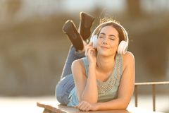 Woman enjoying listening to music in a balcony royalty free stock photography