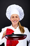 Front view portrait of a young smiling female,chef Royalty Free Stock Images