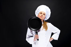 Front view portrait of a young smiling female with frying pan Royalty Free Stock Photos