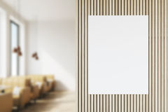 Front view of poster in coffee shop. Front view of a poster in a coffee shop interior with beige leather sofas and large windows. Blurred. 3d rendering. Mock up Royalty Free Stock Photos
