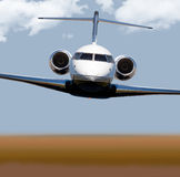 Front view of a private jet in-flight Stock Photography