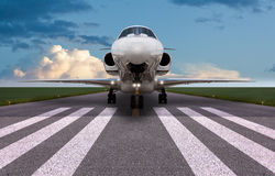 Front view of a private jet on the runway Royalty Free Stock Images