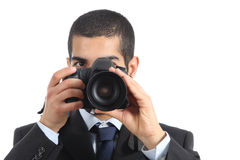 Front view of a professional photographer taking a photograph Stock Photo
