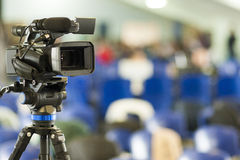 Front View of Professional Videocamera. Positioned Against Blurr Stock Images