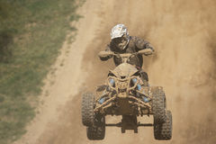 Front view of quad racer jumping Royalty Free Stock Photo