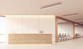 Front view of reception desk in long sunlit corridor Stock Photos