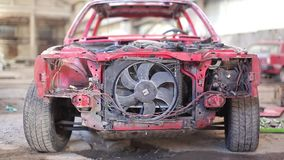 Front view of red old rusty car stock video footage