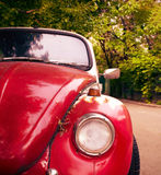 Front view of red retro car. Front view of a red retro car. Close-up of headlight Royalty Free Stock Image