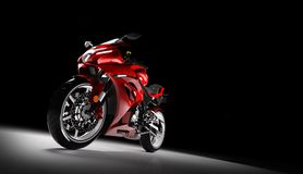 Front view of red sports motorcycle in a spotlight Royalty Free Stock Photo