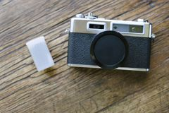 Front View of Retro Film Camera with Film Canister and Lens Cap royalty free stock photo