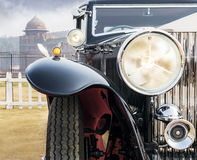 Front view of a Retro / Vintage / Oldtimer Saloon Car. Front low angle view of oldtimer vintage saloon car. The front lights and chrome grill of classic beauty Stock Photo
