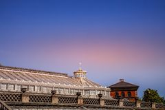 front view of rooftops of buildings during sunset Royalty Free Stock Photos