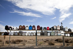 Front view of rows of mailboxes in desert Royalty Free Stock Photography