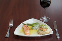 Front view of salmon dish with asparagus Royalty Free Stock Photos