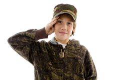 Front view of saluting young boy Royalty Free Stock Photo
