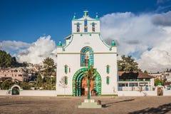 San Bautista church in San Juan Chamula market, Chiapas, Mexico. Front view of the San Bautista church in San Juan Chamula market, Chiapas, Mexico royalty free stock photos