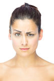 Front view of sceptical woman looking at camera Royalty Free Stock Photography