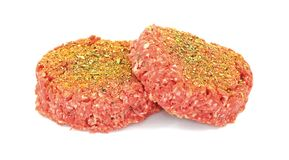 Front View Seasoned Ground Beef Patties royalty free stock photos