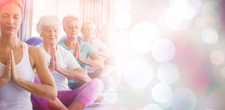 Front view of seniors relaxing with fitness instructor Stock Image