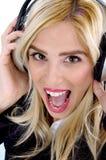 Front view of shouting woman enjoying music Stock Image