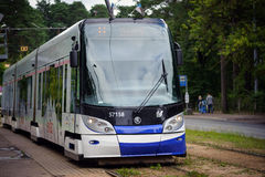 Front view on Skoda 15 T ForCity Tram staying at tram staition of Riga town Stock Photo