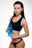 Front view of slim fitness woman drinking water. Full body length portrait  over white background Stock Images