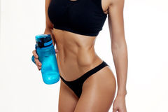 Front view of slim fitness woman drinking water. Royalty Free Stock Photography