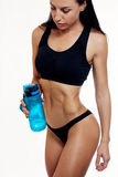 Front view of slim fitness woman drinking water. Royalty Free Stock Image