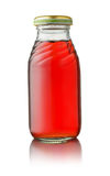 Front view of small glass juice bottle royalty free stock images