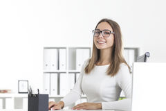Front view of smiling businesswoman in glasses Royalty Free Stock Image