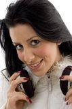 Front view of smiling female holding headphone Royalty Free Stock Images