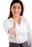 Front view of smiling female offering handshake. On an isolated white background Stock Photography