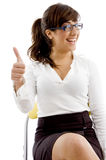 Front view of smiling female with thumbs up Royalty Free Stock Images