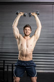 Front view of smiling man lifting weight Royalty Free Stock Photos