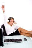 Front view of smiling manager listening music Royalty Free Stock Photography