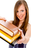 Front view of smiling student showing books stock images