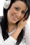 Front view of smiling woman with headphone Stock Photography