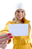 Front view of smiling woman showing business card Stock Photos