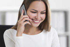 Front view of smiling woman with a smartphone Stock Photos