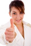 Front view of smiling woman with thumbs up Stock Images