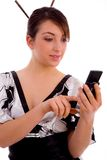 Front view of smiling woman using cell phone Royalty Free Stock Photography