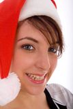 Front view of smiling woman wearing christmas hat Royalty Free Stock Images