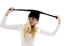 Front view of smiling woman in woolen cap Stock Images