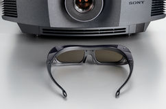 Front view of the Sony VPL-HW40ES home cinema projector with 3D-glasses Royalty Free Stock Images