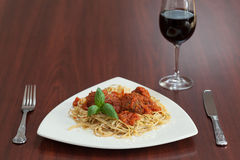 Front view of spaghetti and meatballs with red wine Royalty Free Stock Images