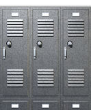 Grey School Lockers Front. A front on view of a stack of grey metal school lockers with combination locks and doors shut on an isolated background royalty free stock photo