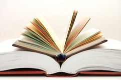 The front view of a stack of open books Stock Images