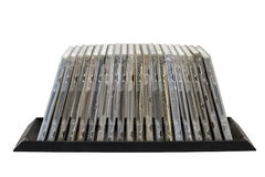 Front View of Stacked Old Grungy Compact Disk Holders Royalty Free Stock Photography