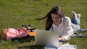 Front View of a Student Girl Working With Laptop In Park of a University Campus. Front View of a Happy Student Girl Working With Laptop In Park of a University stock video footage